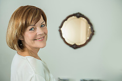Portrait of senior woman in front of mirror, smiling