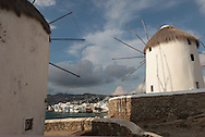 Windmills and the island of Mykonos, Greece.  Photograph by Dennis Brack