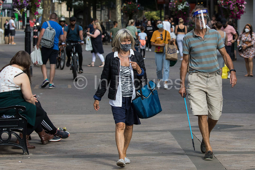 Shoppers wear face coverings and a visor to help prevent the spread of the coronavirus on 20 September 2020 in Staines-Upon-Thames, United Kingdom. The Borough of Spelthorne, of which Staines-upon-Thames forms part along with Ashford, Sunbury-upon-Thames, Stanwell, Shepperton and Laleham, has been declared an 'area of concern' for COVID-19 by the government following a marked rise in coronavirus infections which is inconsistent with other areas of Surrey.