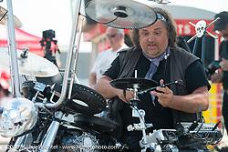 Photographer Horst Rösler plays a drum outfitted custom bike at the Boardwalk Classic Bike Show during Daytona Beach Bike Week. Daytona Beach, FL, USA. March 13, 2015.  Photography ©2015 Michael Lichter.