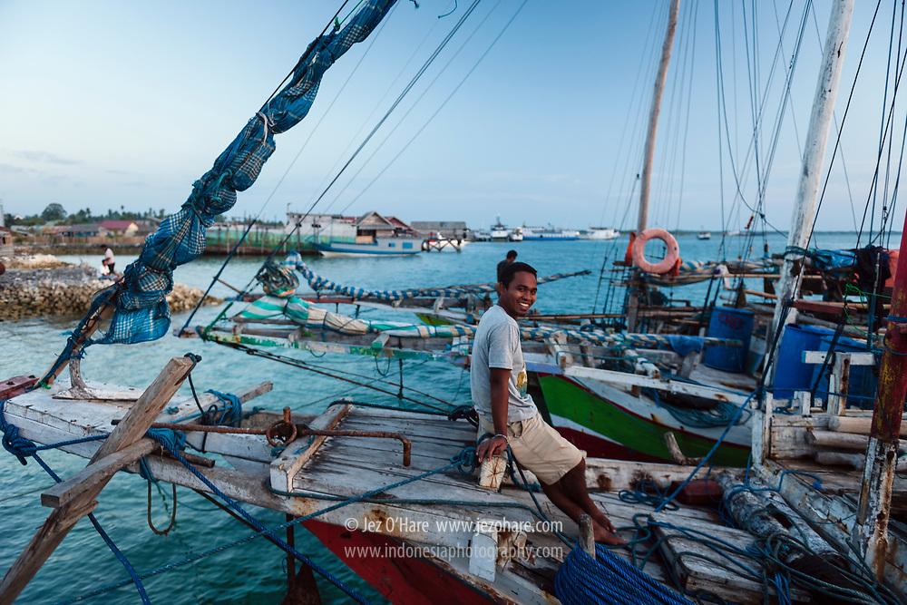 Inal on a sailing boat from Rote island at Wangi-Wangi, Wakatobi National Park, South East Sulawesi, Indonesia.<br /> <br /> Inal, di Kapal berasal dari Pulau Rote yang sedang berlabu di Pulau Wangi-Wangi, Taman Nasional Wakatobi, Kepulauan Tukang Besi, Sulawesi Tenggara, Indonesia