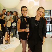 London,England,UK, 11th Aug 2016 : Zuzana and Zuzana attend the wine retailer hosts summer party to sample its award-winning sparkling wine range at Icetank Studios, Lo0ndon,UK. Photo by See Li