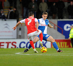 Bristol Rovers' Tom Lockyer challenges Morecambe's Jack Redshaw - Photo mandatory by-line: Dougie Allward/JMP - Tel: Mobile: 07966 386802 14/12/2013 - SPORT - Football - Morecombe - Globe Arena - Morecombe v Bristol Rovers - Sky Bet League Two
