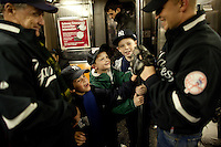 The Schenkler family make their way to Yankees Stadium for Game 1 of the 2009 World Series between the New York Yankees and The Philadelphia Phillies in Bronx, NY. (Photo by Robert Caplin)..