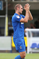 AFC Wimbledon striker James Hanson (18) applauding fans during the EFL Sky Bet League 1 match between AFC Wimbledon and Coventry City at the Cherry Red Records Stadium, Kingston, England on 11 August 2018.
