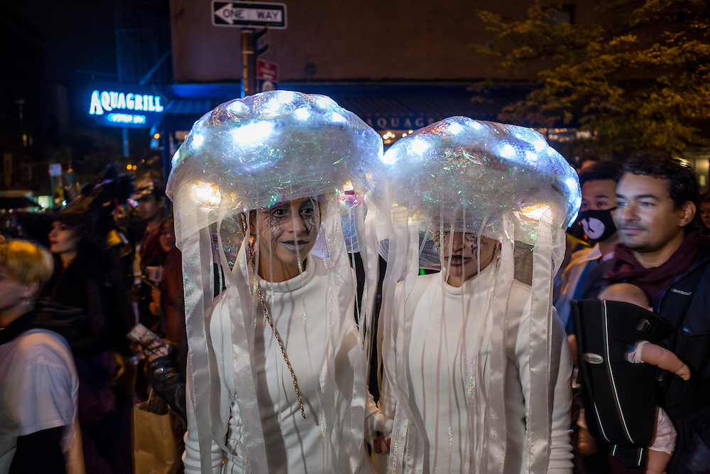 New York, NY - 31 October 2015. Two women wearing costumes that appeare to be jellyfish in the annual Greenwich Village Halloween Parade.