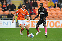 Peterborough United's Mohamed Eisa under pressure from Blackpool's Ryan Edwards<br /> <br /> Photographer Kevin Barnes/CameraSport<br /> <br /> The EFL Sky Bet Championship - Blackpool v Peterborough United - Saturday 2nd November 2019 - Bloomfield Road - Blackpool<br /> <br /> World Copyright © 2019 CameraSport. All rights reserved. 43 Linden Ave. Countesthorpe. Leicester. England. LE8 5PG - Tel: +44 (0) 116 277 4147 - admin@camerasport.com - www.camerasport.com