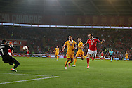 Gareth Bale of Wales ® shoots and scores his teams 3rd goal. Wales v Moldova , FIFA World Cup qualifier at the Cardiff city Stadium in Cardiff on Monday 5th Sept 2016. pic by Andrew Orchard, Andrew Orchard sports photography