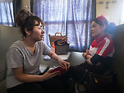 Two students return to Kashgar. Life inside the train - mostly Muslim Uighur people  ride this train.
