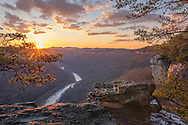 The trees yield to winter, allowing the craggy rim and the evergreens of the New River Gorge in West Virginia to steal the focus as the setting sun highlights every pore and pine on Beauty Mountain.