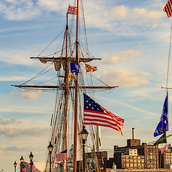 Baltimore, MD, USA - June 16, 2012: American flag flies on a tall ship at dock in the Inner Harbor of the City of Baltimore, Maryland.