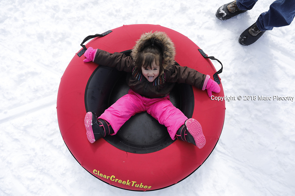 """SHOT 3/11/18 2:53:27 PM - Winter activities including cross country skiing, snowshoeing, tubing and winter fishing on Bear Lake in Garden City, Utah. Bear Lake is a natural freshwater lake on the Utah-Idaho border in the Western United States. The lake has been called the """"Caribbean of the Rockies"""" for its unique turquoise-blue color, which is due to the reflection of calcium carbonate (limestone) deposits suspended in the lake. Bear Lake is over 250,000 years old. (Photo by Marc Piscotty / © 2018)"""