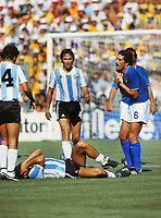 Football - Italy v Argentina World Cup 1982 29/06/1982<br /> <br /> Diego Maradona (ground) holds his hands to his head, as Claudio Gentile (Italy) claims his innocense .<br /> <br /> Credit : Colorsport / Andrew Cowie