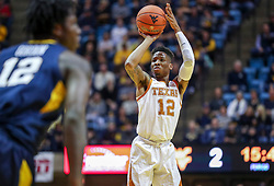 Feb 9, 2019; Morgantown, WV, USA; Texas Longhorns guard Kerwin Roach II (12) shoots a three pointer during the first half against the West Virginia Mountaineers at WVU Coliseum. Mandatory Credit: Ben Queen-USA TODAY Sports