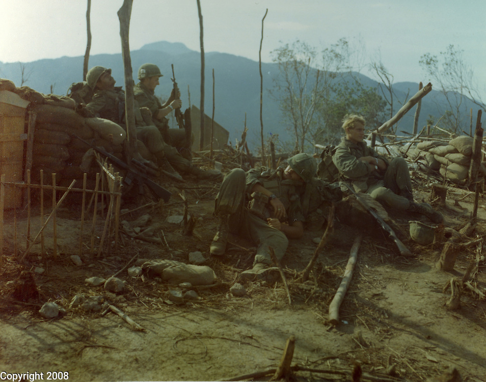 Members of the 2nd Battalion, 7th Infantry, 1st Cavalry Division rest after breaking down the equipment on Landing Zone pepper while awaiting transportation back to Camp Evans. 11 May 1968..