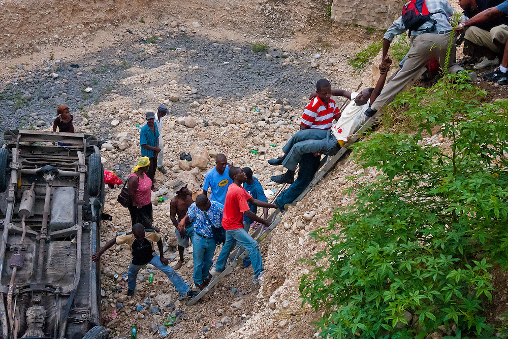 A tap tap (public transport) veers off the road and ended up at the bottom of the cliff.  Traffic accident is common in Haiti due to overcrowding and horrible road conditions.