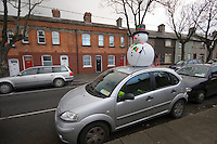 Inflatable snowman on a car roof in Dun Laoghaire Dublin Ireland