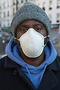 """March, 26th 2020 - Paris, Ile-de-France, France: Parisians wearing a range of masks and facial coverings in the hope of protecting themselves from the spread of the Coronavirus, during the eigth day of near total lockdown imposed in France. A week after President of France, Emmanuel Macron, said the citizens must stay at home from midday on Tuesday for at least 15 days. He said """"We are at war, a public health war, certainly but we are at war, against an invisible and elusive enemy"""". All journeys outside the home unless justified for essential professional or health reasons are outlawed. Anyone flouting the new regulations is fined. Nigel Dickinson"""