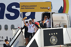 15.07.2014, Flughafen Tegel, Berlin, GER, FIFA WM, Empfang der Weltmeister in Deutschland, Finale, im Bild Philipp Lahm (GER) verlaeest mit dem WM-Poakl als Erster die Lufthansamaschine, dahinter Bastian Schweinsteiger (GER) // SPO during Celebration of Team Germany for Champion of the FIFA Worldcup Brazil 2014 at the Flughafen Tegel in Berlin, Germany on 2014/07/15. EXPA Pictures © 2014, PhotoCredit: EXPA/ Eibner-Pressefoto/ Hundt<br /> <br /> *****ATTENTION - OUT of GER*****
