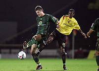 Photo: Paul Thomas.<br /> Watford v Norwich. Coca Cola Championship.<br /> 13/09/2005.<br /> <br /> Norwich's Jason Shackell beats Ashley Young to the ball.