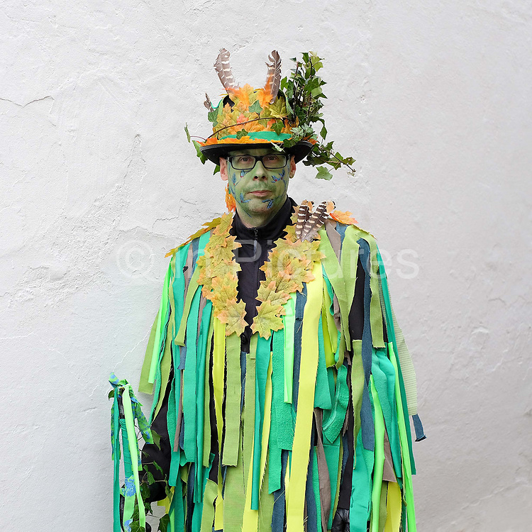 Portrait of the Green Man at an orchard-visiting wassail in Kilham village, Yorkshire Wolds, UK on 21st January 2017. Wassail is a traditional Pagan winter celebration in cider-producing regions of England, reciting incantations and singing to the trees to promote a good harvest for the coming year. Pieces of toast soaked in cider are hung in the branches to attract robins to the tree as these are said to be the good spirits of the orchard. To ward off evil spirits, villagers scare them away by banging pots and pans and making as much noise as possible
