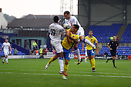 Exeter City's Graham Cummins is sandwiched between Tranmere Rovers' Clayton McDonald and Danny Holmes. Skybet football league two match, Tranmere Rovers v Exeter city at Prenton Park in Birkenhead, the Wirral on Saturday 20th Sept 2014.<br /> pic by Chris Stading, Andrew Orchard sports photography.