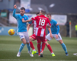 Forfar Athletic's Brad Spencer and East Fife's Scott Linton. Forfar Athletic 3 v 0 East Fife, Scottish Football League Division One game played 2/3/2019 at Forfar Athletic's home ground, Station Park, Forfar.