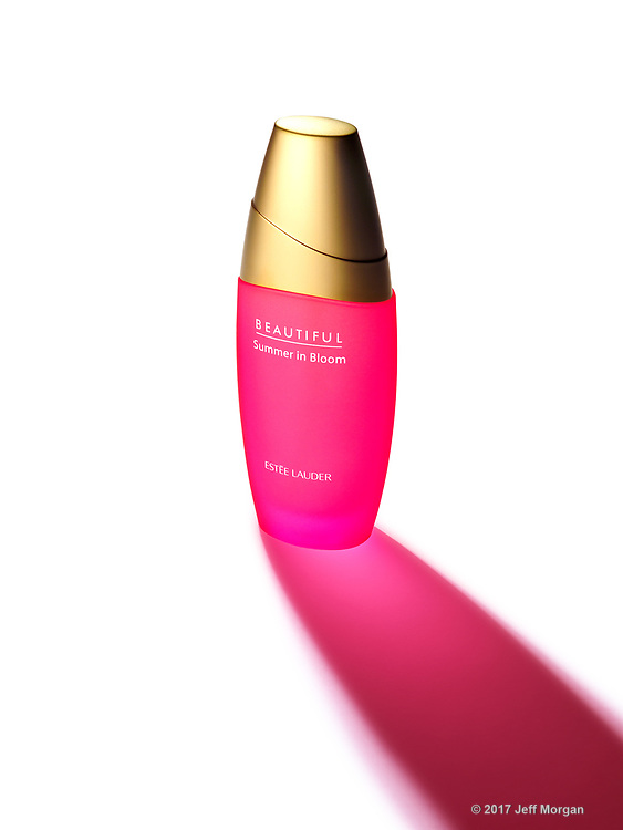 Estee Lauder, Beautiful bottle with dramatic shadow.