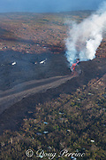 lava erupting from fissure 8 of the Kilauea Volcano east rift zone in Leilani Estates residential subdivision, near Pahoa, pours out of its cinder cone and flows downslope as a river of lava toward Kapoho, lower Puna District, Hawaii Island ( the Big Island ), Hawaiian Islands, U.S.A. ( Pacific Ocean )