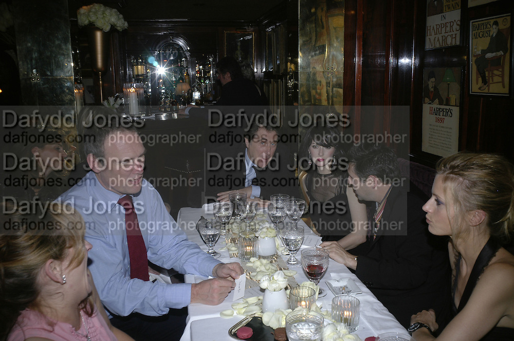 A.A. Gill, Bryan Ferry, Katherine Turner and Laura Bailey, Charles Finch and Chanel 7th Anniversary Pre-Bafta party to celebratew A Great Year of Film and Fashiont at Annabel's. Berkeley Sq. London W1. 10 February 2007. -DO NOT ARCHIVE-© Copyright Photograph by Dafydd Jones. 248 Clapham Rd. London SW9 0PZ. Tel 0207 820 0771. www.dafjones.com.
