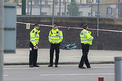 © Licensed to London News Pictures. 02/04/2019. London, UK. Police officers at the crime scene on Grafton Road, junction with Vicars Road in Kentish Town, north west London where a man in his 20s was found stabbed around 8.30pm on Monday 1 April 2019. He was pronounced dead at the scene. Photo credit: Dinendra Haria/LNP