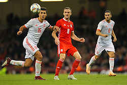 October 11, 2018 - Cardiff City, Walles, United Kingdom - Cardiff, Wales October 11, ..Andy King of Wales passes the ball while under pressure from Rodri of Spain during Exhibition Match between Wales and Spain at Principality stadium, Cardiff City, on 11 Oct  2018. (Credit Image: © Action Foto Sport/NurPhoto via ZUMA Press)