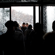 January 26, 2014 - Kiev, Ukraine: A anti-government protestors pass by the chattered glass doors of the Ukraine House, hours after violent confrontations with the riot police. (Paulo Nunes dos Santos)