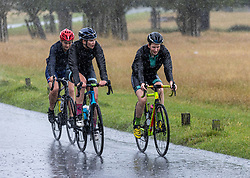 Licensed to London News Pictures. 07/08/202. London, UK. Summer washout. Cyclists get caught in torrential rain in Richmond Park southwest London today as thunderstorms continue to hit the South East with further showers expected tomorrow. Yellow weather warnings for England have been issued for thunderstorms with heavy rain, and possible flooding as the bad weather is set to continue until Monday. However brighter weather is finally forecast for next week with highs of 23c. Photo credit: Alex Lentati/LNP