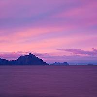 Festvågtinden mountain peak rises from sea near Henningsvaer, Viewed from Stamsund, Lofoten islands, Norway