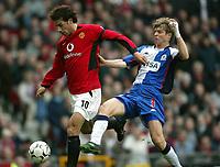 Photo. Aidan Ellis.<br />Manchester United v Blackburn Rovers.<br />FA Barclaycrad Premiership.<br />22/11/2003.<br />Manchester's Ruud Van Nistelrooy beats Blackburn's Vratislav Gresko to the ball to score United's first goal