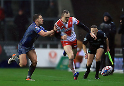 St Helens' Adam Swift loses possession under pressure from Wakefield Trinity Wildcats' Scott Grix during the Betfred Super League match at the Totally Wicked Stadium, St Helens.