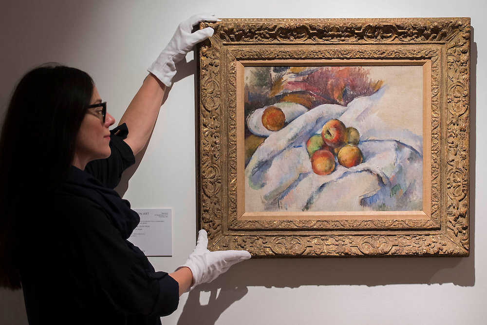 PAUL CÉZANNE (1839-1906)<br /> Pommes sur un linge<br /> Painted circa 1885<br /> Estimate: $7,000,000-10,000,000 - Christie's showcases  the London Post-War and Contemporary Art Evening Sale in October, alongside an exceptional selection of works from the  New York sales in November of Impressionist, Modern, Post-War And  Contemporary Art. The works will be on view to the public from Saturday 10 October to Saturday 17 October at Christie's King Street. The highlight is  Amedeo Modigliani's, 'Nu couché (Reclining  Nude)', painted in 1917-18, which has an estimate in the region of $100 million.