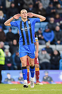 Gillingham FC forward Tom Eaves (9) scores a goal (2-0) and gestures to away fans during the EFL Sky Bet League 1 match between Gillingham and Bradford City at the MEMS Priestfield Stadium, Gillingham, England on 27 October 2018.