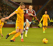 Preston North End Defender, Paul Huntington looks to sheperd out the ball from Burnley Defender, Tendayi Darikwa during the Sky Bet Championship match between Burnley and Preston North End at Turf Moor, Burnley, England on 5 December 2015. Photo by Mark Pollitt.