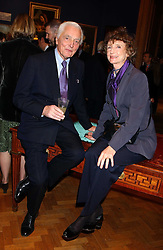 The EARL OF AIRLIE and LINDY, MARCHIONESS OF DUFFERIN & AVA at a reception hosted by Brian Ivory Chairman of the Trustees of The National Galleries of Scotland to commemorate Sir Timothy Clifford's 21 years of Director of the National Gallery of Scotland and his forthcoming retirement in January 2006, held at Christie's, King Street, London W1 on 6th December 2005.<br /><br />NON EXCLUSIVE - WORLD RIGHTS