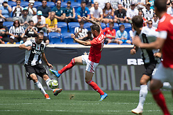 July 28, 2018 - Harrison, New Jersey, United States - Juventus defender GIORGIO CHIELLINI (3) cross the ball while challenged by SL Benfica forward FACUNDO FERREYRA (19) during the International Champions Cup at Red Bull Arena in Harrison, NJ.  Juventes vs Benfica (Credit Image: © Mark Smith via ZUMA Wire)