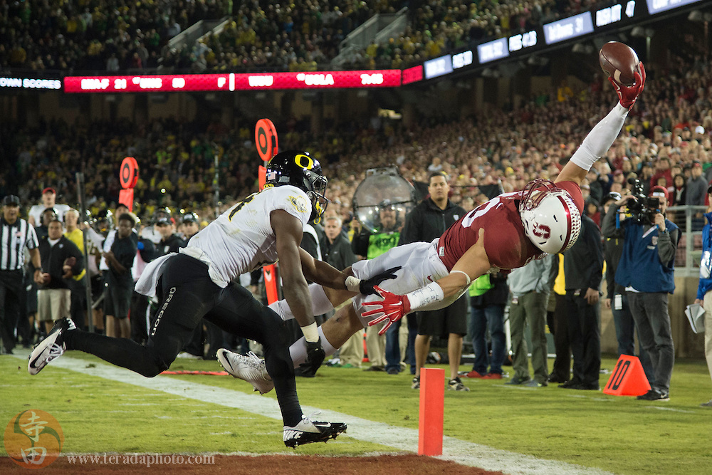 November 14, 2015; Stanford, CA, USA; Oregon Ducks cornerback Ugo Amadi (14, left) is called for defensive pass interference against Stanford Cardinal wide receiver Devon Cajuste (89, right) during the fourth quarter at Stanford Stadium. The Ducks defeated the Cardinal 38-36.