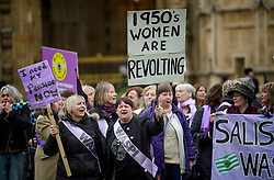© Licensed to London News Pictures. 08/03/2017. London, UK. Woman campaign with the group WASPI (Women Against State Pension Inequality), outside The House of Parliament in London, on the day that  British chancellor Philip Hammond delivers his 2017 Budget to Parliament. Photo credit: Ben Cawthra/LNP