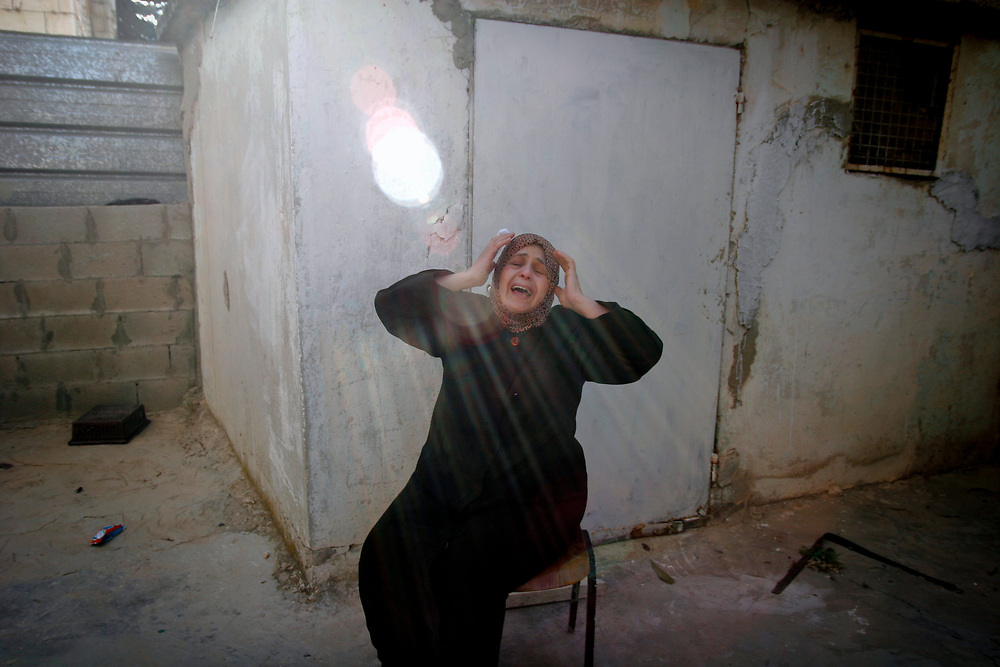 A Palestinian woman reacts during the funeral of Arab taxi driver Taysir Karaki, 35, at his family house in the east Jerusalem neighborhood of Beit Hanina, on May 15, 2007. Julian Soufir, a French-Israeli man. Police investigators said they believed the dual citizen went to Jerusalem on a specific hunt for an Arab cabbie, then lured him into the downtown apartment and killed him.