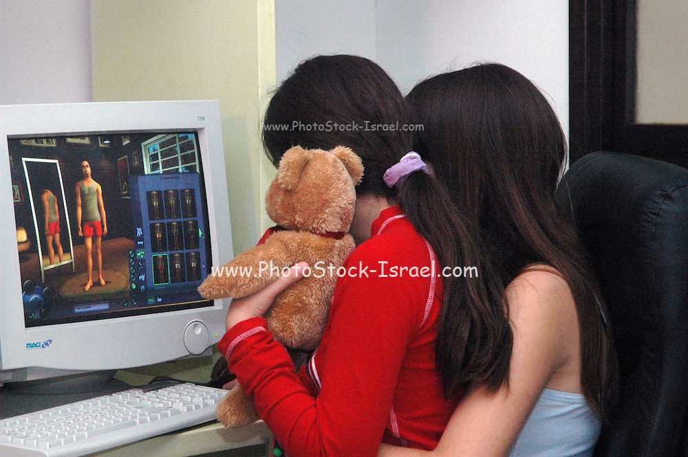 two young female girls 11 years old enjoying the moment with their teddy bear toy