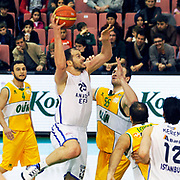 Anadolu Efes's Ermal Kurtoglu (C) during their Turkish Basketball League match Anadolu Efes between Olin Edirne at the Ayhan Sahenk Arena in Istanbul, Turkey on Sunday, 17 March, 2013. Photo by TURKPIX