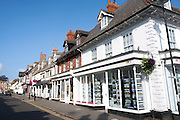 Row of shops in historic buildings in Highworth, Wiltshire, England, UK