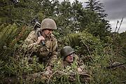 USA, Oregon, Astoria, Ft. Stevens State Park, living historian machine gun team displacing. MR