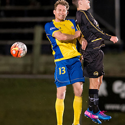 BRISBANE, AUSTRALIA - AUGUST 26: Sam Knight of the Strikers and Stephen Green of Moreton Bay compete for the ball during the NPL Queensland Senior Men's Semi Final match between Brisbane Strikers and Moreton Bay Jets at Perry Park on August 26, 2017 in Brisbane, Australia. (Photo by Patrick Kearney)